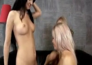 Three dykes play with dildo