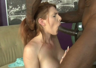 Red haired white slutty girlie takes long black dick in her pink bald twat