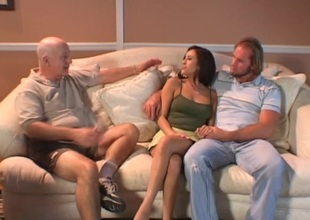 Devoted brunette in high heels and miniskirt getting gangbanged hardcore in a reality discharge
