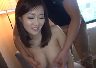Beautiful Oriental chick with massive tits enjoying a hardcore doggy style fuck