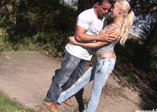 Out in the forest that guy gets her out of her jeans and onto his cock