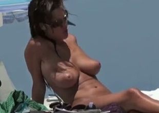 Milf with perfect natural tits gets caught on my webcam on nude beach