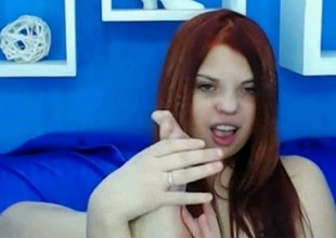 Redhead beauty shows her toes for the livecam and sucks them
