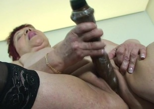 This large mama sure loves her hard dildo