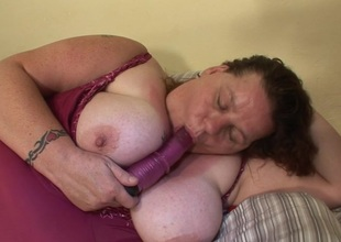 Large mature slut playing with herself