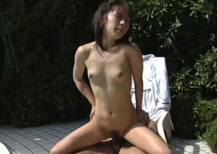 Japanese skank is drilled in a standing doggy position by the poolside