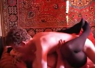 Russian mature woman copulates a youthful guy