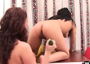 Horny Oriental pro with bald pussy and her dark brown join up have fun with cucumber