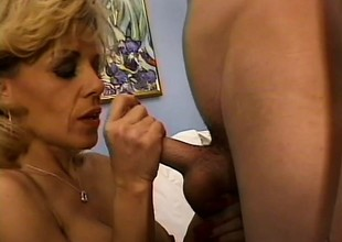Experienced blonde lady knows some tricks for pleasing young dick