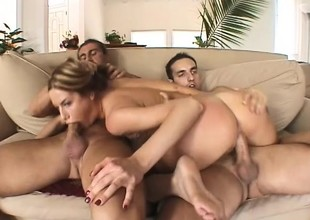 Busty Young Blond Takes On Two Dicks