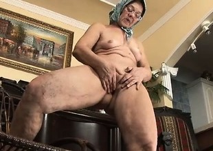 Grandmother giving some head and pussy to an overexcited young hick