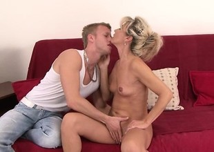 Sexy skinny aged blonde gets fucked at the end of one's tether a young guy on the couch