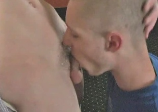As in a short time as those two hardened muscle-boys get home, they close the door, take one look at each other, and start melting all over each other with lust.  The bald and scruffy dude holds the more clean-cut guy against the wall and fellates him, not letting h