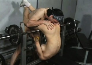 Athletic redhead with large round tits gets double penetrated in the gym