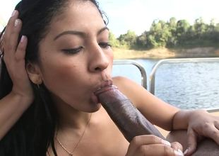 Two Colombian girls are sucking off a guy in a threesome on a boat