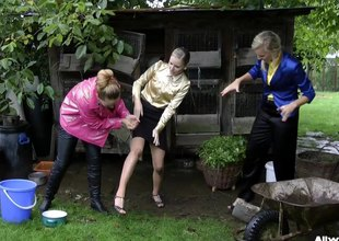 Three dressed glamorous bombshells getting messy in the garden