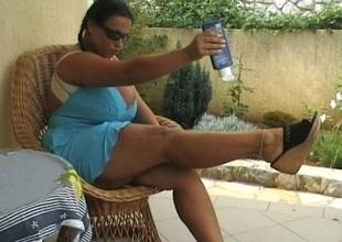 Brunette honey outside on the squeaker massaging her big bra buddies
