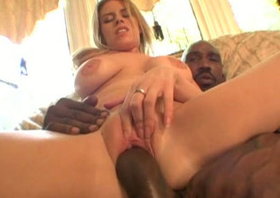 Breasty white tart Daphane Rosen rides on a big black shaft