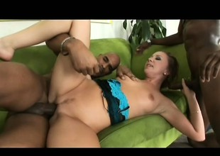 Attractive playgirl joins two black studs on the couch for a hot threesome