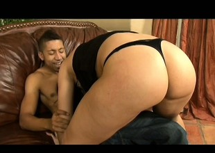 Wild dark brown with a sublime ass fucks a huge black stick with fervor