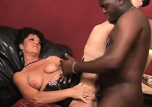 Horny white MILF in nylons takes it from a huge black dong