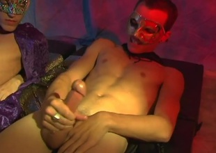 Jason Raze and Justin Case both stroke their large hard cocks for us at a mascarade party. They stroke until they both discharge a sexy load of cum all over their chests and stomachs. Very sexy climax...