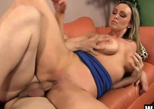 Large breasted blonde cougar Abbey Brooks seduces and bonks a young stud