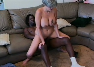 Busty venerable woman can't get sufficiently of a black prick drilling her cunt