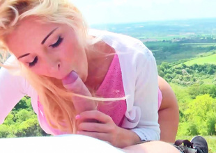 Delightful blonde is shaking her naked gazoo in the mountains