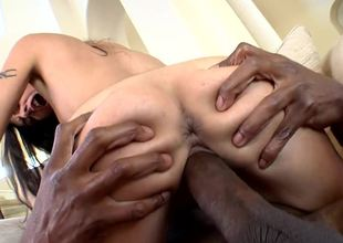 Pierced clit slut Lou Charmelle sits on a black dick and rides