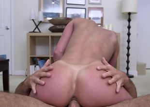 Brunette with large tits likes it when her tits are held on to