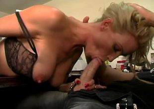 Busty golden-haired Diamond Foxxx wastes no time showing off her massive tits to Brian Surewood. She oils them up nicely in advance of dropping down to her knees to suck on his massive cock! She gets her tits fucked for some time in advance of Brian slams her cunt and then sw