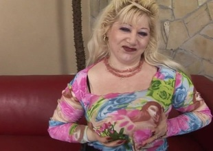 This sexy mature blond gets herself off with toys