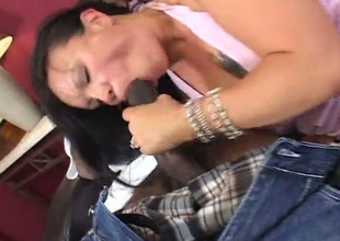Filthy brunette sucks a large black cock and then rides it like a boss