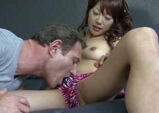 Cute Japanese whore with curly hair sucks alluring white prick passionately