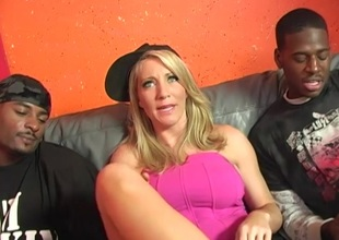 Tasty dame with fake tits endure a rough fuck in this interracial threesome