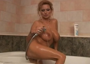 Randy playgirl with big tits masturbates during the time that bathing in tub