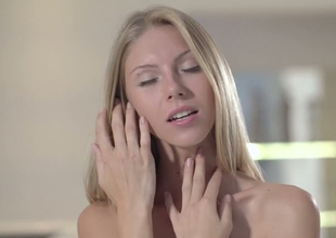 Mesmerizing tow-headed angel Angelica takes off her panties