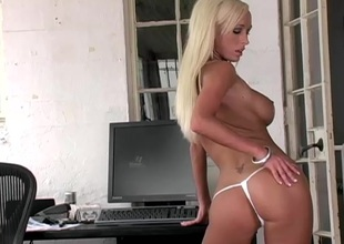 A blond shows off her huge mounds while fingering her fuck hole