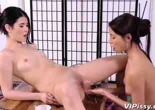 Stunning Oriental whores rub each other down before having
