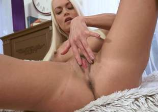 Lovely long-haired blonde Lina Love parts her legs to play with her tight pussy fro your viewing pleasure. This babe makes her lean to disappaer in her love tunnel right in front of the cam