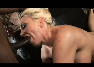 Sexy golden-haired MILF taking all of his hard black cock in every hole