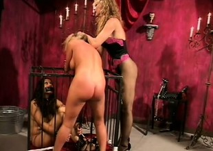 Bound golden-haired slave gets some rough treatment in thraldom scene