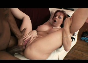 A nasty housewife with massive tits takes a big coloured boning