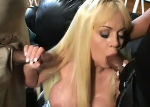 MILF gets two gigantic diabolical dicks in the one and the other her holes at one's fingertips one time