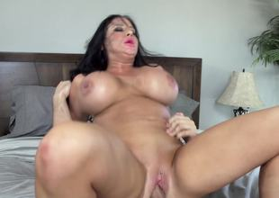 Massive fake titties on the milf babe riding a big dick