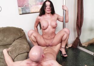 Slut with a stripper pole in her abode likes athletic fucking