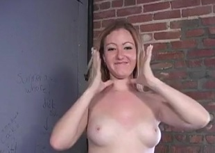 Blondie was pleasantly surprised to find a black dong in a glory hole