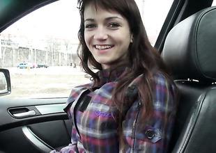 Dark brown Aimee gets undressed in the car