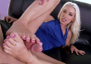 This blonde has legs that go on for forever. She's going to use them feet to make his cock real wonderful and hard, ergo a footsie is just the thing for this mo fo